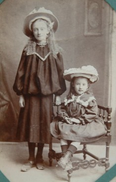 Florence Hogg Whitfield (sitted) with an elder sister c 1909